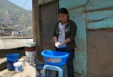 A child domestic worker washes outdoors in Peru