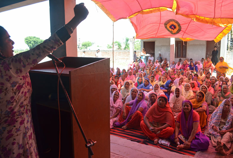 Women in community meeting, India