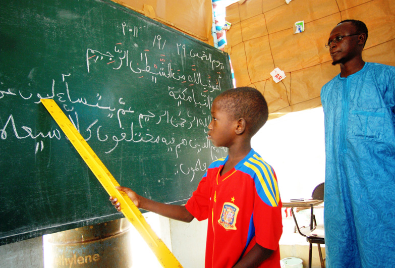 Senegal child at blackboard