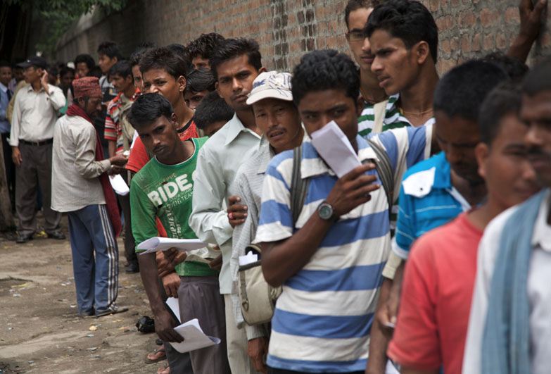 Prospective migrants queue up for a passport in Kathmandu, Nepal.
