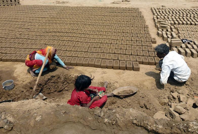 Family working in brick kiln in India