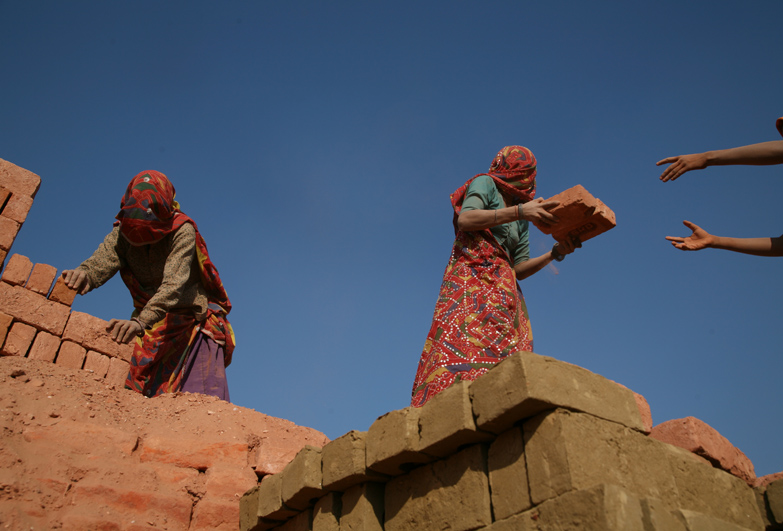 A family in debt bondage, also known as bonded labour or debt slavery, working in a brick-kiln in India.