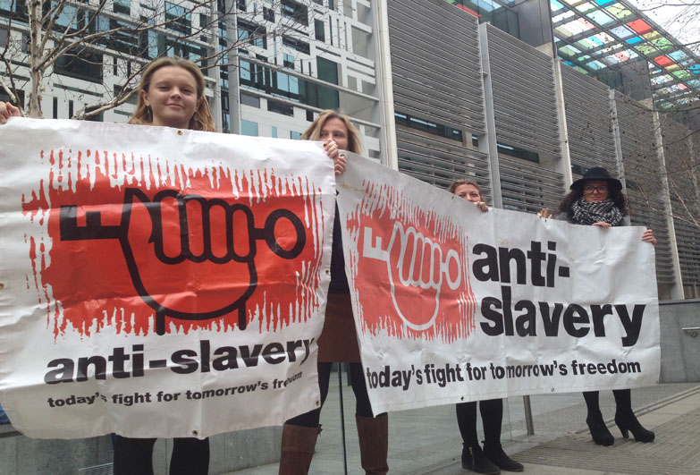 Anti-Slavery staff demonstration and holding banner