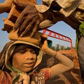 Bonded labourer in brick kiln, India
