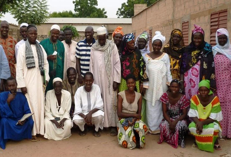 Group photo of men and women, community leaders in Senegal