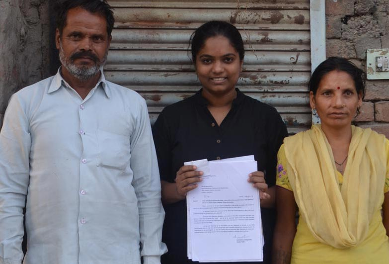 Anti-Slavery International partners Volunteers for Social Justice with workers and their bondage release certificate