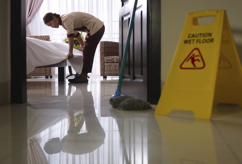 Worker cleaning luxury hotel room