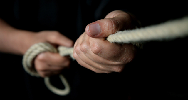 photo of hands pulling ropes