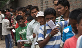 Nepali workers queueing for permits to migrate to the Middle East