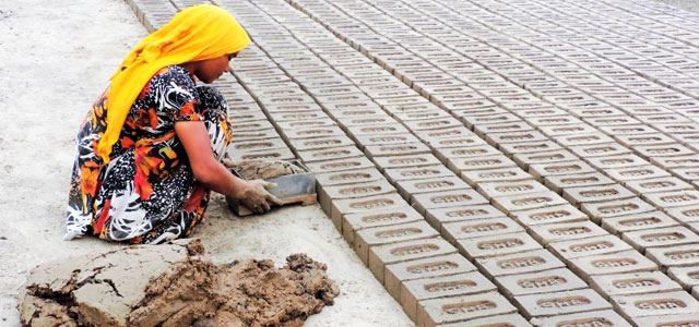 image of a woman working in a brick kiln