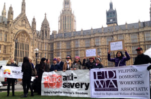 Photo: Protest outside of the Parliament demanding protections for overseas domestic workers