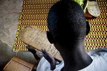 Child learning Koran in Senegal school