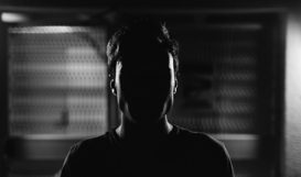 Man standing in shadow