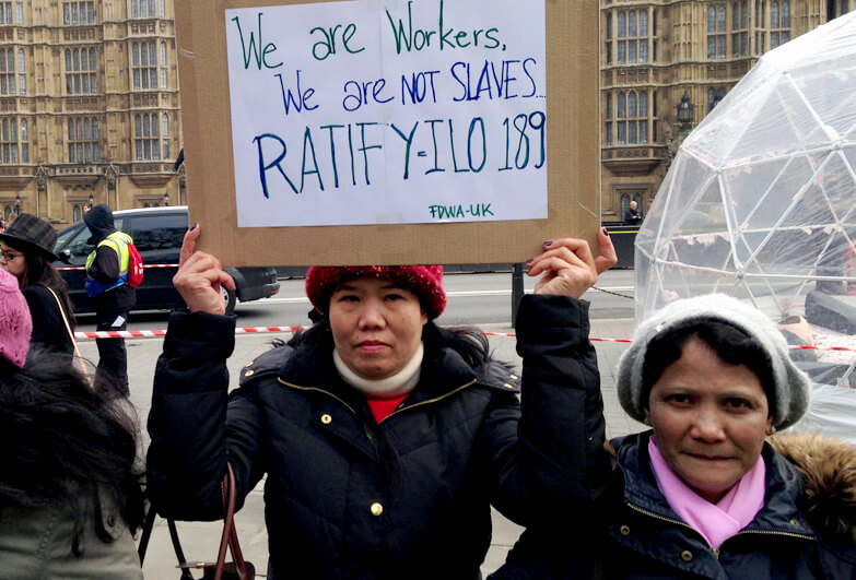 Women outside the UK Parliament demanding protection for migrant domestic workers