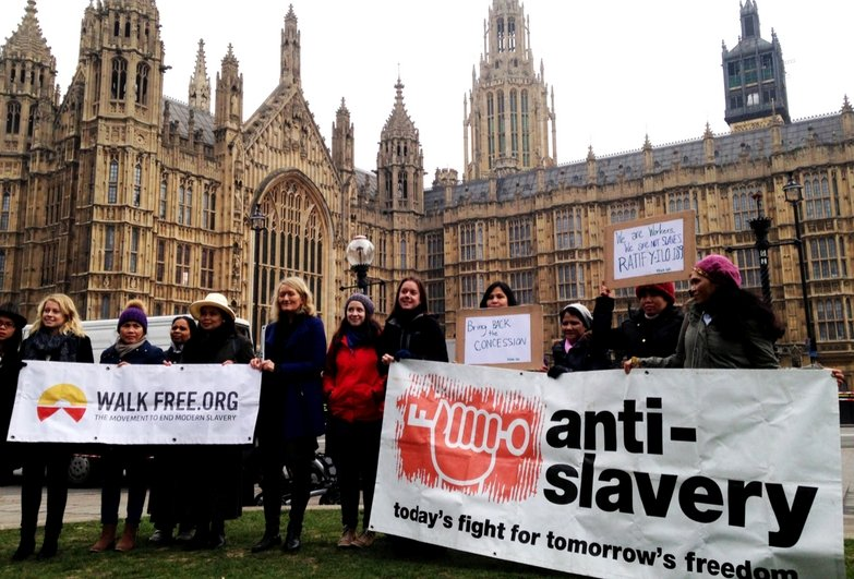 Protest outside the Houses of Parliament demanding to step up the fight against modern slavery in the UK