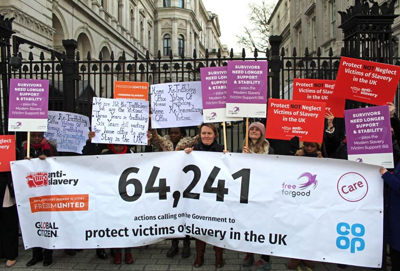 Petition hand in group outside Downing Street London