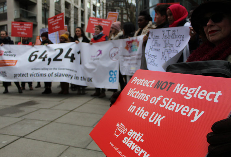 Anti-Slavery supporters holding banners outside the home office