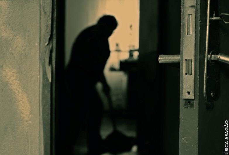 woman domestic worker in dark room