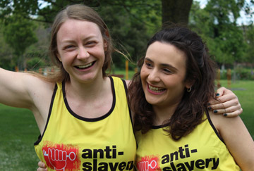 Two runners wearing Anti-Slavery vests
