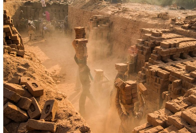 workers in dusty brick kiln