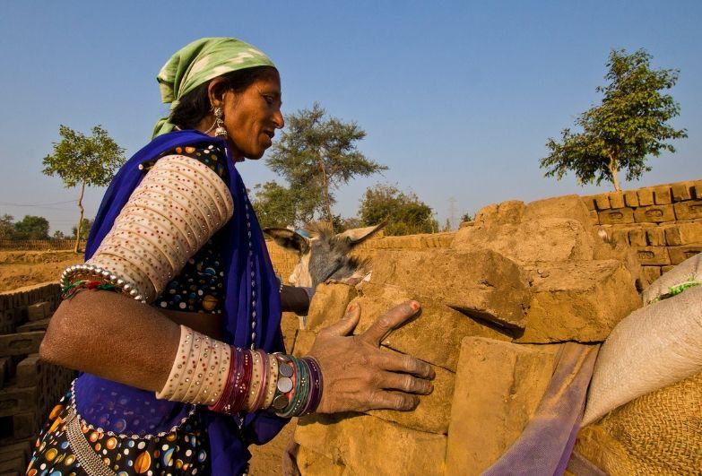 female brick maker in India