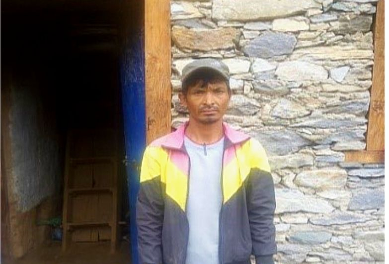 haliya man in front of his house