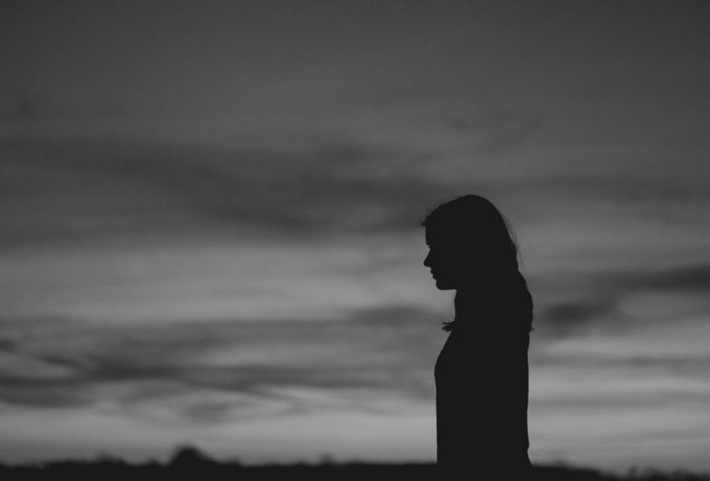 Woman with sky in background
