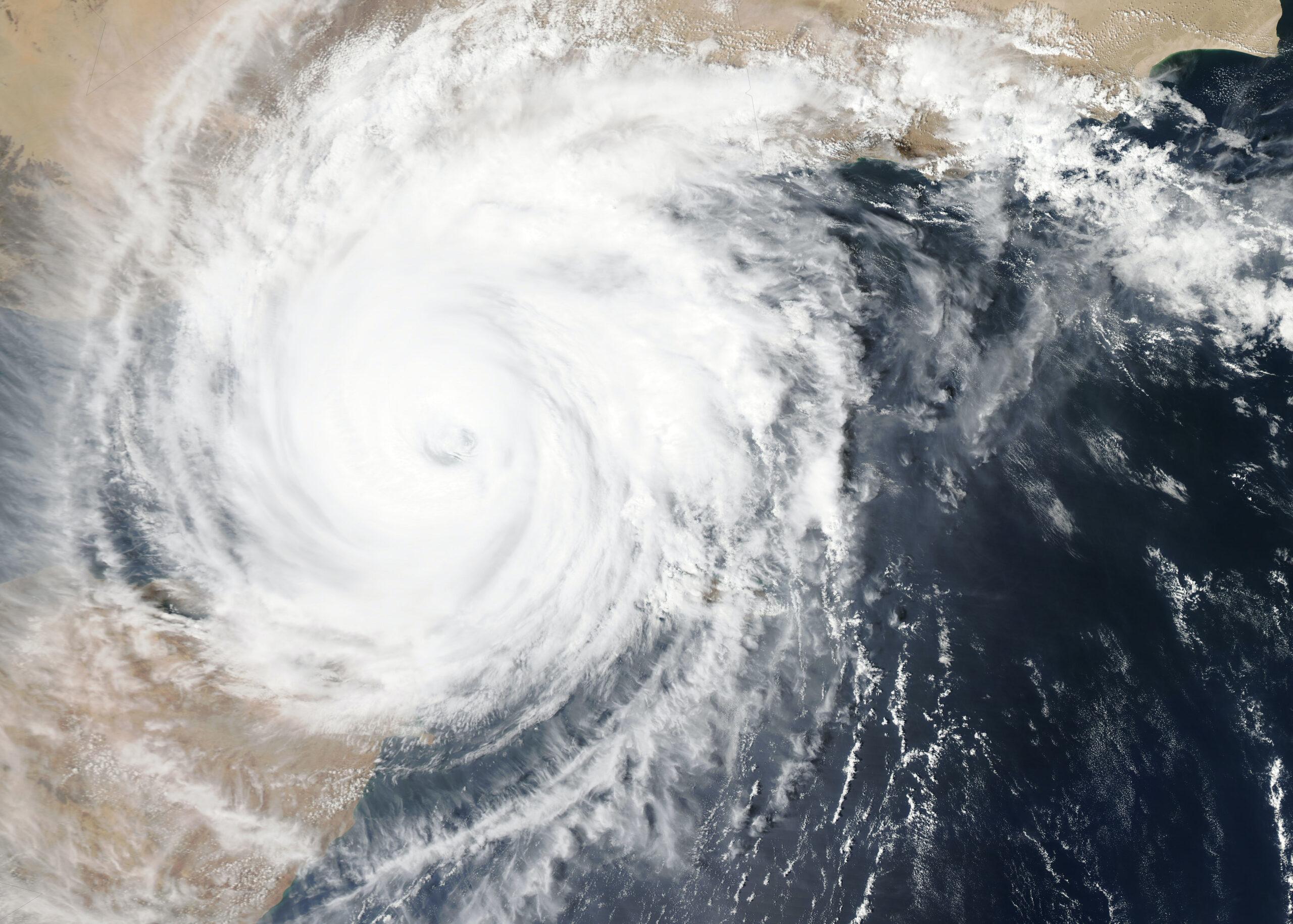 climate change and modern slavery - hurricane satellite image